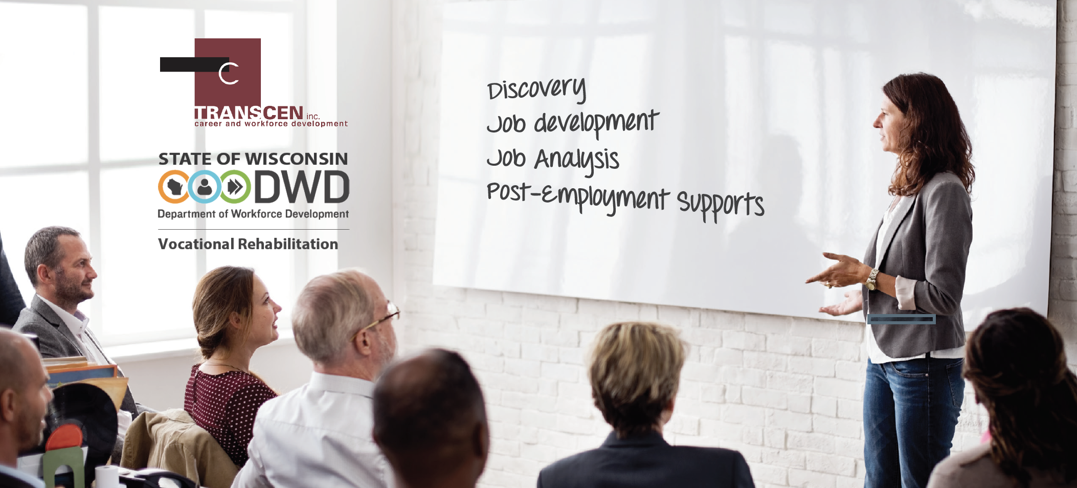 Person teaching a workshop with the words: Discovery, job development, job analysis and post-employment supports on the white board.